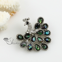 peacock sea water rainbow abalone shell and rhinestone brooch
